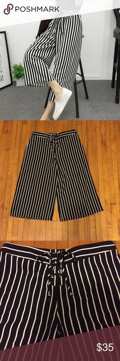 """Pedal Pusher/ Wide Leg Pants Black and White pedal pusher/ wide leg pants. Size medium. Garterized at the back, thus, can be stretched from medium to large. With string ribbon in front waist. Its brand new with no tag. No damage, no stain, no rips. I wore it (see photos) just for sample. Im 5'4"""" in height. In excellent condition. agaci Pants Wide Leg"""