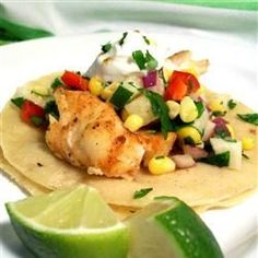 """Fiery Fish Tacos with Crunchy Corn Salsa   """"Spicy grilled fish are cooled down with a fresh crunchy veggie salsa featuring fresh corn. Your guests will swim back for seconds!"""""""