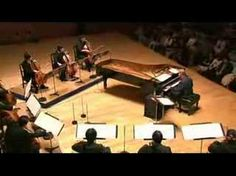 Joe Hisaishi - Piano and Nine Cellos - Madness. Really great video from DVD concert.