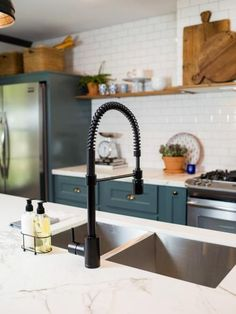 A close up of the farm sink in the kitchen of the newly renovated Jones home, as seen on Fixer Upper. (after)
