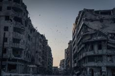 National Geographic 2014 Photo Contest: Destroyed Homs - (Birds fly over the destroyed houses, Khalidiya District, Homs, Syria) - photo by Sergey Ponomarev Photography Office, Photography Contests, Nature Photography, Photography Tricks, Photography Competitions, Photography Awards, Amazing Photography, Photographie National Geographic, National Geographic Photography