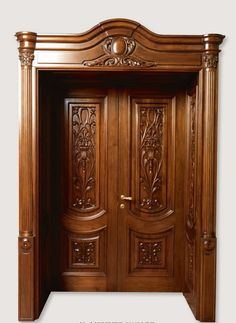 LUIGI XVI 4014/QQ/INT. A pillar antique-effect finish Siberian walnut with panelling on the frame and carved front panels Luigi XVI© Classic Wood Interior Doors | Italian Luxury Interior Doors | New Design Porte Emotions
