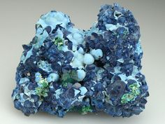 A rare specimen of Shattuckite as pseudomorps after crystals of Calcite, associated with Dioptase and Plancheite. Tantara Mine,  DR Congo
