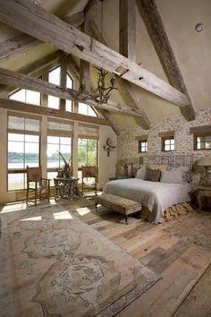 Majestic open barn bedroom with floor to ceiling windows and beautiful beams. 2020