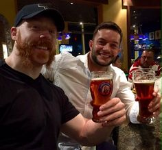 sharing a pin in Dublin with balor...Sheamus is trying to console the poor chap for not being a ginger. Also, he's on the shandy.