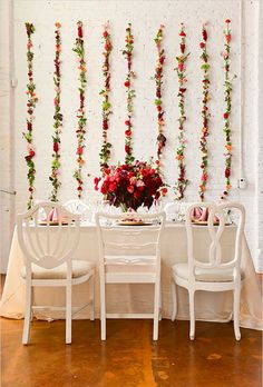 Brides.com: . For a fresh (not to mention more affordable!) take on the flower wall, affix flower stems on a wall in a linear pattern to create a modern backdrop for the head table. Created by Lalé Florals.
