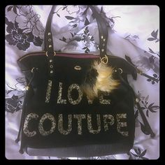 """Juicy Couture Purse This barely used beautiful black Juicy Couture bag has leopard print """"I Love Couture"""" letters in the front followed with an adorable furry ball clipped to the strap. On the inside, it's pink and has a secret compartment for makeup and 2 other decent sized pockets. This bag fits a lot of stuff! Juicy Couture Bags Shoulder Bags"""