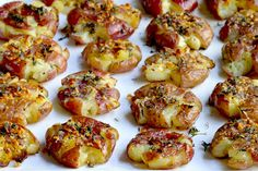 Roasted baby red potatoes, partially smashed down, drizzled with a mixture of butter, garlic and thyme, then roasted again until browned and crispy.