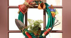 Garden hose wreath hangs on a front door