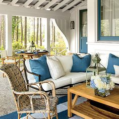 Porch: The Details | Treat the furniture arrangements like you would inside—but not the materials. The porch is exposed to the elements, so outfit it accordingly with outdoor fabrics and rugs, such as these Sunbrella cushions and pillows.