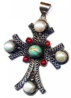 """Turquoise, Pearl, Coral and Sterling Silver Large Cross Pendant - 368 This unique rustic handcrafted cross pendant features a 12mm round turquoise, 10mm fresh water pearls, 5mm round coral and antiqued sterling silver. The pendant is about 3 1/2"""" long, including the bail.  $87.50"""