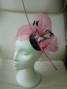 Tocado tonos rosa y negro. Más en natalialuzentupelo.blogspot.com.es