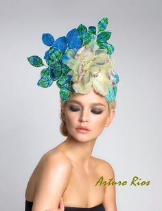 Headpiece made from a mix of aqua / turquoise dupioni Silk, adorned with 2 Silk magnolias and iridescent green/blue/tuquise Vintage Japanese Velvet leafs.