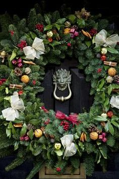 Good ideas for making a sturdy wreath for large 8' front doors.
