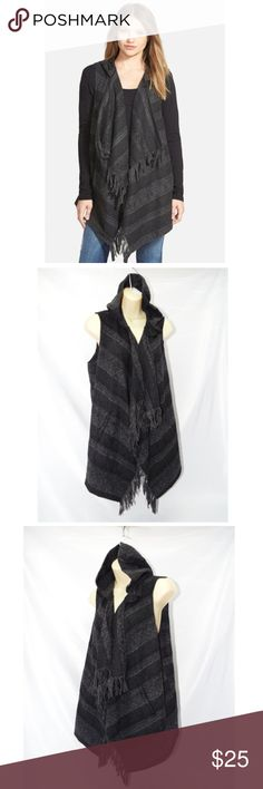 "Jolt Hooded Fringe Drape Front Vest-NEW! Cool blanket stripes and fluffy fringe trim bring a little Wild West attitude to a hooded vest styled with a cascading waterfall front.   new without tags  29"" front length; 27"" back length. Front button closure. Front pockets. 90% polyester,10% wool. Dry clean. By Jolt; imported.  retail $99 #8471 Jolt Jackets & Coats Vests"