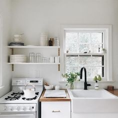 Cute & clean white kitchen // butcher block counter top // farmhouse apron sink