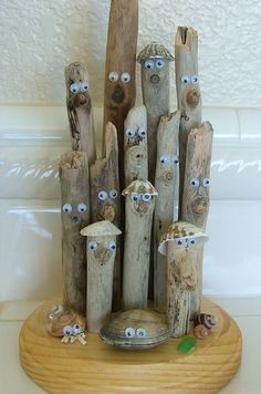 Humorous, whimsical drift wood sculpture with a seaside theme. Constructed of driftwood, shells, and some beach glass for color collected from California beaches. The eyes give funny expressions to each piece and every sculpture is unique. Add some humor to your seashore or nautical themed décor. A great addition to your beach house or getaway that will amuse your family and friends. Stands about 9 inches tall and the base is about 5 inches in diameter. The bottom of the base has felt pads…