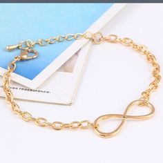 Gold infinity bracelet Cute simple gold infinity unisex bracelet it's 8 inches without extension and 10 inches with extension and is adjustable new in baggy 5 available Jewelry Bracelets