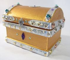 Treasure chest. Made from a Paper Mache box from Hobby Lobby. Decorate for a Princess theme or change for a Pirate theme treasure chest. Ideas: tiara, wand, feather boa