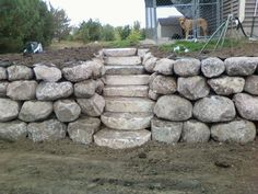 stone steps with boulder wall