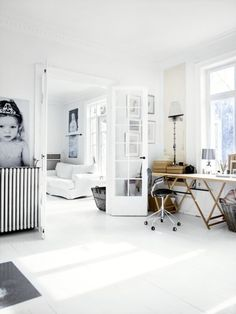 Clean simple room with black and white family photos as the prefect accent(s).