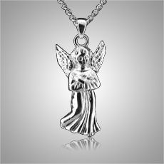 The Guardian Angel Keepsake Pendant is made from sterling silver and is a wonderful cremation ash pendant. The pendant will keep your loved one close to your heart forever. This Keepsake Pendant holds a small amount of the ashes, a piece of hair or anything small enough to memorialize your loved one and keep them close and with you at all times.