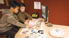 Hands-on Robotics for kids using Tangible Coding pieces at Robot Park in Boston Museum of Science (pic via Northwestern Univ)