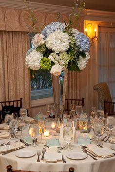 tall centerpieces mixed colors of hydrangeas/   Deland Florida wedding flowers/ Volusiacountyweddingflowers/ www.callaraesfloralevents.com