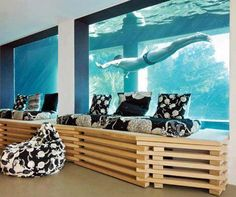 In ground swimming pool that has glass sides and dips into the basement. GET. ME. THIS. NOW.
