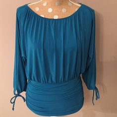 8/17/16🎉HP🎉Dressy Turquoise Top Stylish turquoise blue rusched top. Has stretch to it. Worthington Tops