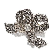 ANTIQUE DIAMOND BOW BROOCH, CIRCA 1880.  The mesh bow with articulated ends set with 23 old-mine diamonds weighing approximately 3.25 carats and with numerous small old-mine and rose-cut diamonds, mounted in silver and rose gold, brooch fitting detachable.
