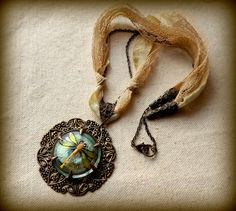 Large filigree pendant with iridescent dragonfly by lilruby, $75.00