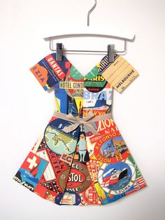 Folded Paper Dress    this sells for $74 on Etsy (some crafty staff person should figure out how to do this)  Charity/mm