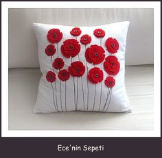 *Felt flowers. :) It the contrast in colors that make the flowers 'pop'. Cute! ~H.