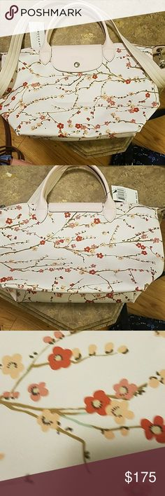 Longchamp tote Nwt authentic longchamp tote light pink with floral pattern.  This is a medium ef77a7aafcb78