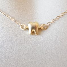Gold Tooth Necklace Silver Tooth Necklace by WanderingDandelion