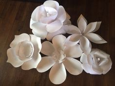Paper flowers for wedding backdrop.. Wedding decorations on a budget!