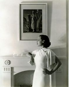 Dolores del Rio with what look likes a painting by Jean Dupas