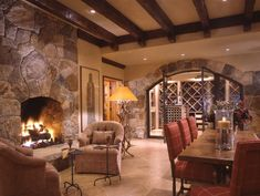 Love the Bar & Wine Cellar relationship, and the cozy fireplace with seating is a great bonus!