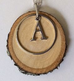 Monogram A charm Essential Oil Diffuser Necklace Made with Magnolia Wood by LowcountryEclectic $15.00 FREE SHIPPING--Do you know anyone who loves aromatherapy and has the letter A in their name?  Then this necklace would be perfect for them!