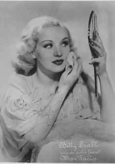 Betty Grable applying the finishing touches to her make-up. #vintage #1930s #beauty #actresses