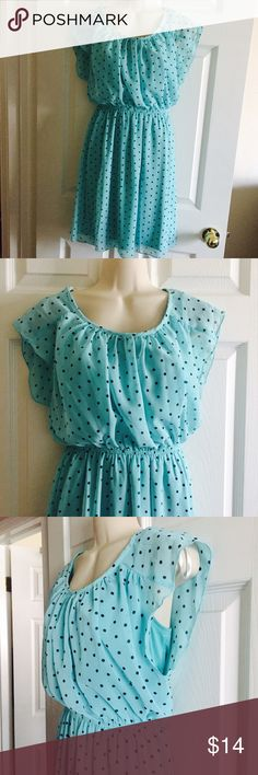 Polka Dot Dress Sz 6 Super cute dress in like new condition.  Only worn once.  Color is Aqua blue/green color.   size 6 with lining.  100% polyester.  NO TRADES Enfocus Studio Dresses