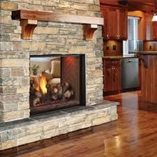 Love the stacked rock! see through fireplace