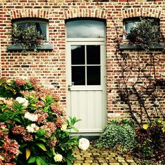 """Typical smart house in my Flemish village - light grey paintwork, cobblestones, lots of white hydrangeas often the only flowering plant, clipped hedges -…"""
