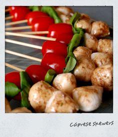 Best party snack!!  Cherry tomato + basil leaf + fresh mozzarella + balsamic = amazing!