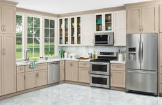 """30"""" Range, 27.8 cu.ft. French Door Refrigerator, Dishwasher, And Microwave Oven"""