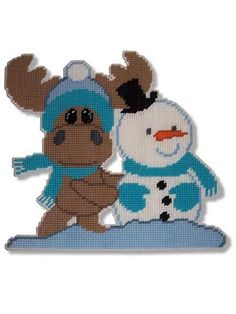 """This adorable wall hanging of pals, Moose and Snowman, celebrates the joys of the winter season. Size: 13"""" x 13"""". Made with medium (worsted) weight yarn and 7-count plastic canvas. Skill Level: Beginner"""