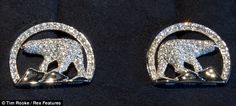 The platinum and diamond pave cufflinks in the shape of the Northwest Territories polar bear logo gifted to Prince William & Katherinn on their Canadian trip