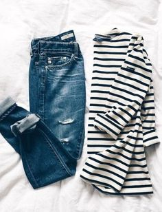 Basic babe in worn in jeans and Saint James stripes.