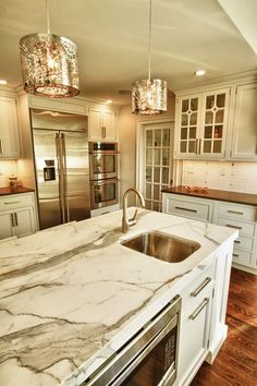Contemporary Kitchen with Calacatta Classic Marble Countertop, Glass panel, Complex marble counters, Large Ceramic Tile